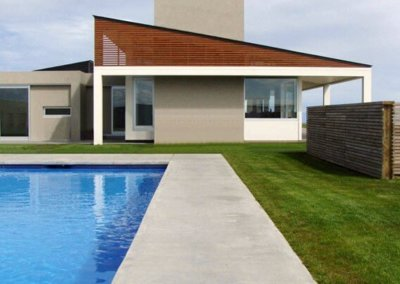 BOOM ROCK HOME pool and side of house