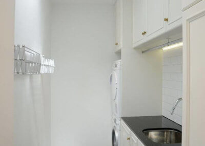 Tinakori Home laundry room, with washer dryer and sink